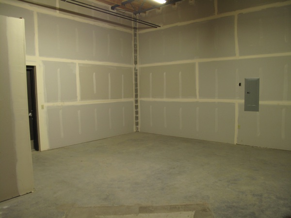 This is the wall in the back that will have an archway into the other space, where the food room will be